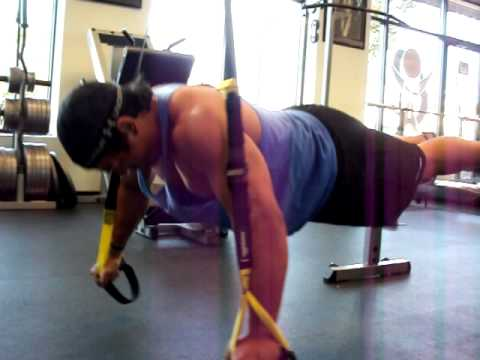 Suspended bodyweight chest fly