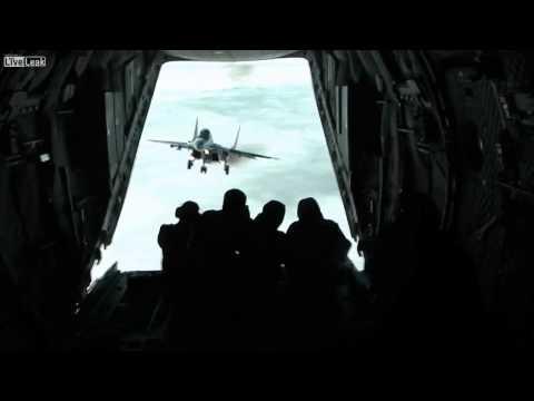 MiG-29 Flies Impossibly Close To An Aeroplane's Open Rear Door