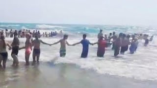 40 Strangers Form Chain to Rescue Swimmers on Lake Michigan