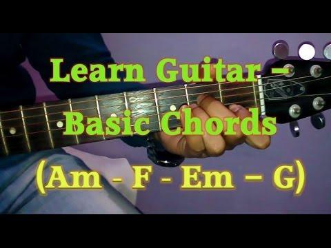 Learn Basic Guitar Chords- Beginners Guitar Tutorial | A Minor Chord Progression | vguitarlearning.