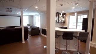 A Stunning Basement Bar And Home Theater In Littleton, MA