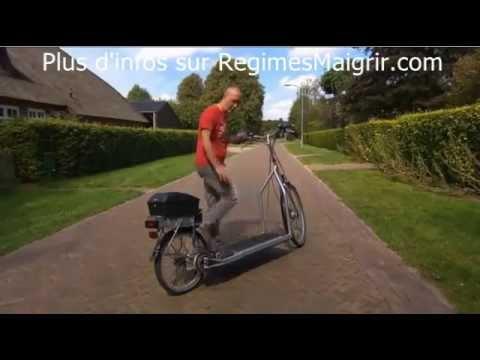 Vélo elliptique qui fonctionne avec un tapis roulant posé dessus
