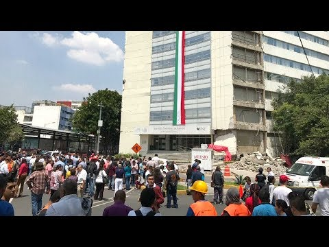 Dramatic collapse of government  building during Mexico quake