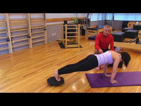 Plank – Knee Tuck