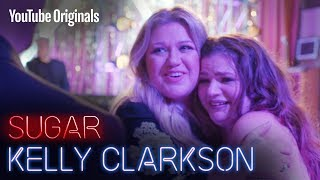 Kelly Clarkson crashes a fan's wedding for the first dance.
