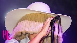 Sia Reveals Her Face In Concert - VIDEO