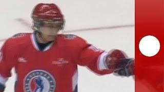 Putin scores crowd cheers: Russian President shows off hockey skills in Sochi