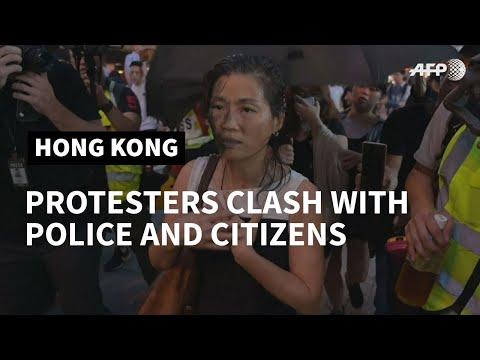 Hong Kong police make arrests as 'flashmob' protests hit pro-Bejing targets   AFP