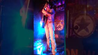 "Aarons Watson sings ""Fence Post"" in Nashville at Exit In in 2015."
