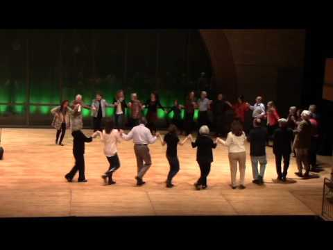 Image of Hi-Dukes live performance of Thalassaki Mou in concert as a quintet at the University of Missouri-St. Louis, Touhill Performance Center Lee Theater in 2016 with the audience dancing on stage.