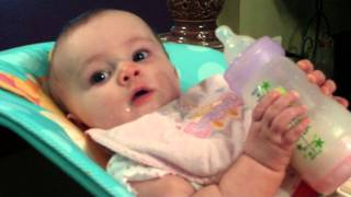 How we taught our baby to hold her bottle