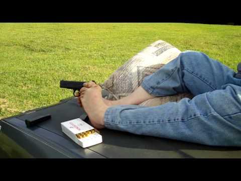 Armless man shoots gun with feet (vid)