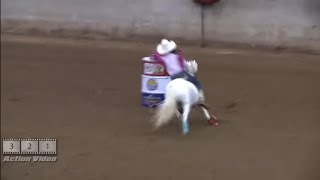 Cute little Girl Running Barrels on a little horse at All American Youth Barrel Race
