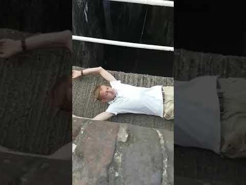 British guy tries to jump over a canal.