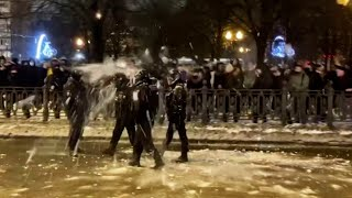 video: Watch pro-Navalny protesters pelt riot police with snowballs in Moscow