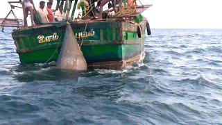 NET FISHING BY BOAT LAUNCHER
