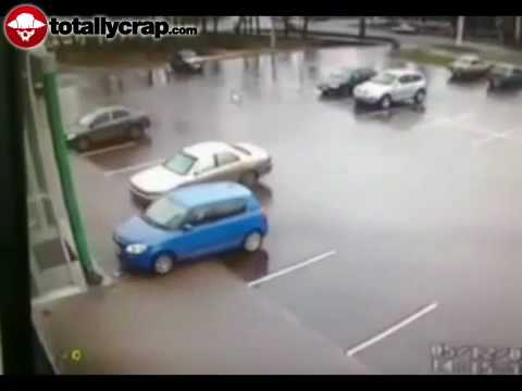 Woman crashes car in empty parking lot