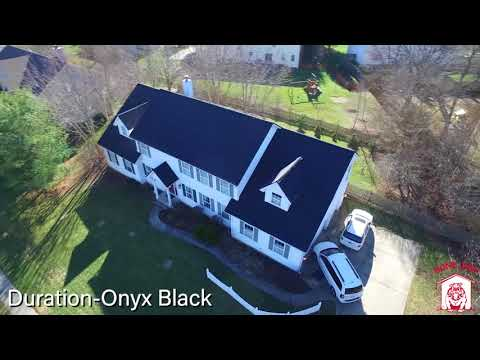 A beautiful home with a new Duration Onyx Black shingle color installed.