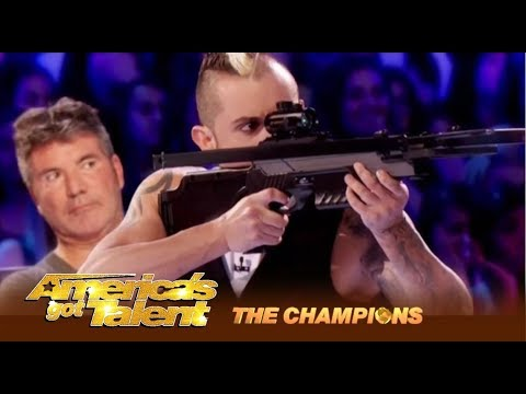 Deadly Games: Man SHOOTS At His Wife and It's Kind Of SEXY! | America's Got Talent: Champions (видео)