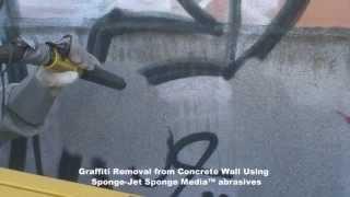 Grafiti valymas nuo fasado su smėliasrove