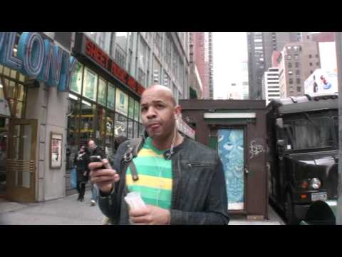 Guy stops New Yorkers and asks what they are listening to on their headphones