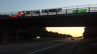 ECHO Action's lighted signs on a Raymond overpass get honks to stop Granite Bridge Pipeline