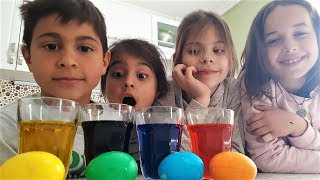 Nut's family. Mikail, Elis and Meryem coloring eggs.