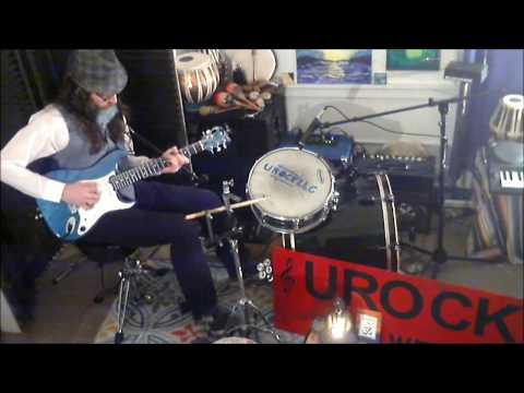 This is how I like to perform.  I modified a guitar to hold bass strings and play a drum set with my feet using pedals.