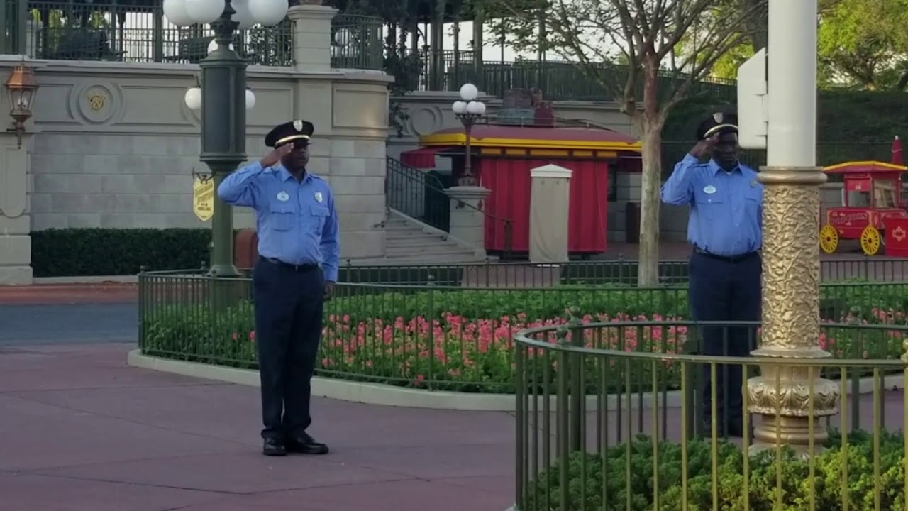 Raising the flag at a closed Magic Kingdom due to COVID-19