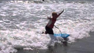 Alex kneeling on boogie board