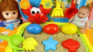 Baby doll sand and surprise eggs play baby Doli house