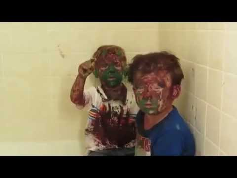 Dad can't stop laughing while trying to punish sons covered in paint