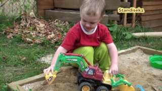 Bagr na písku / baby playing with a digger in the sand (2.5 years)