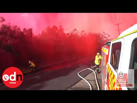 Australian Firefighters Soaked in Red After Flame Retardant Airdrop