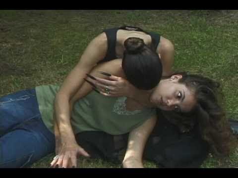 Female Vampire bites woman