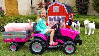 Stacy plays with farm toys