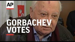 Ex-Soviet leader Gorbachev votes, comments on spy scandal
