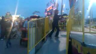 kid doing the pee pee dance at the SD fair