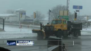 Plow crews working to clear ice and snow from roads