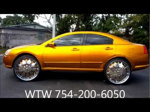 """AceWhips.NET- WTW Customs- Female's candy Gold Mitsubishi Galant on 26"""" DUB Presidential Floaters"""