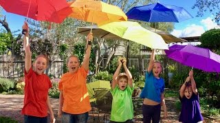Learn English Colors! Rainbow Umbrellas! It's Raining Water Balloons with Sign Post Kids!