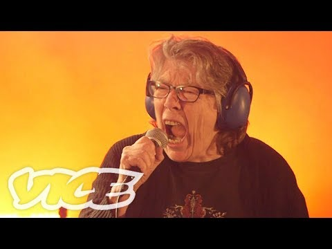 The Grindmother Cometh (2018) A short doc from Vice about Grindmother, a 68 year old Canadian grandmother turned grindcore singer.