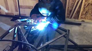 """Lawrence """"LT"""" Tolman using the Forney 190 MIG in his home workshop"""