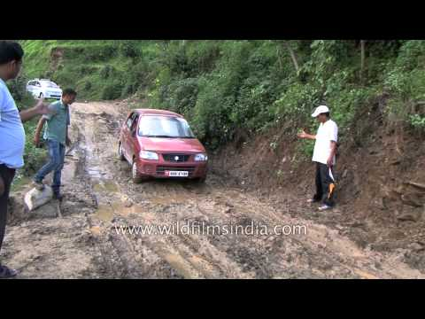 Maruti Suzuki Car Struggles To Cross Muddy Road - Men Place Stones To Let Car Pass In Ukhimath