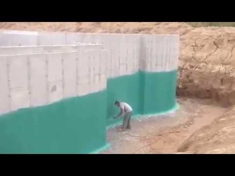 This video shows Rub-R-Wall Waterproofing being spray-applied to a poured concrete foundation.