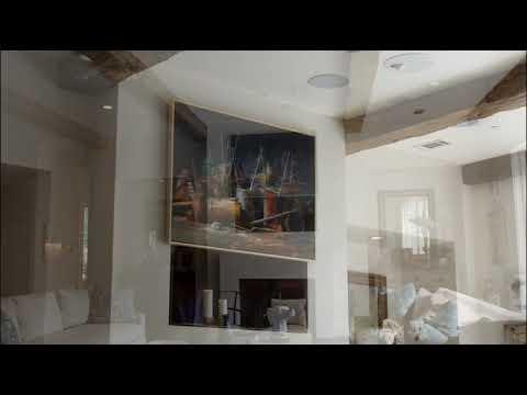 Lighthouse Technologies: Hidden TV Behind Art: Houston Family Room