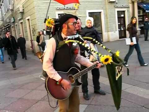 An amazing one-man-band street performer in Rijeka, Croatia called Cigo Man Band.  http://www.youtube.com/user/CigoManBand
