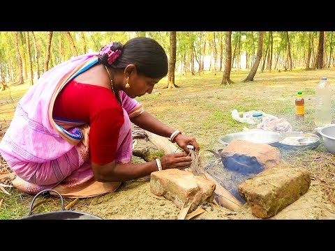 Village Lady Showing How to Cook Dried Fish Recipe in Traditional Style