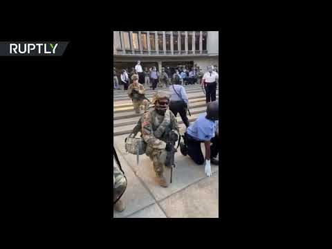 A moment of unity | National Guardsmen & Philadelphia police kneel before demonstrators