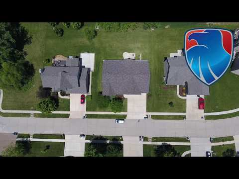 We reroofed this home after high winds significantly damaged the roof. We worked with the homeowner's insurance company to get them the new roof they deserved. The new roof looks great!